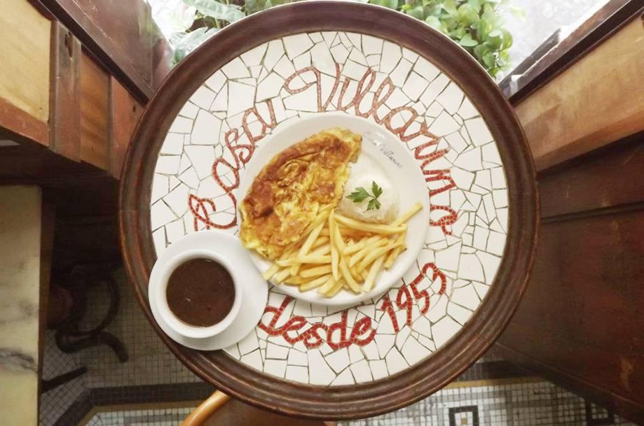 """<a href=""""http://viajeaqui.abril.com.br/estabelecimentos/br-rj-rio-de-janeiro-restaurante-villarino"""" rel=""""Villarino"""" target=""""_blank""""><strong>Villarino</strong></a>    O omelete à Felipe Junqueira é uma das opções do Villarino, o bar que é conhecido como um dos berços da Bossa Nova."""