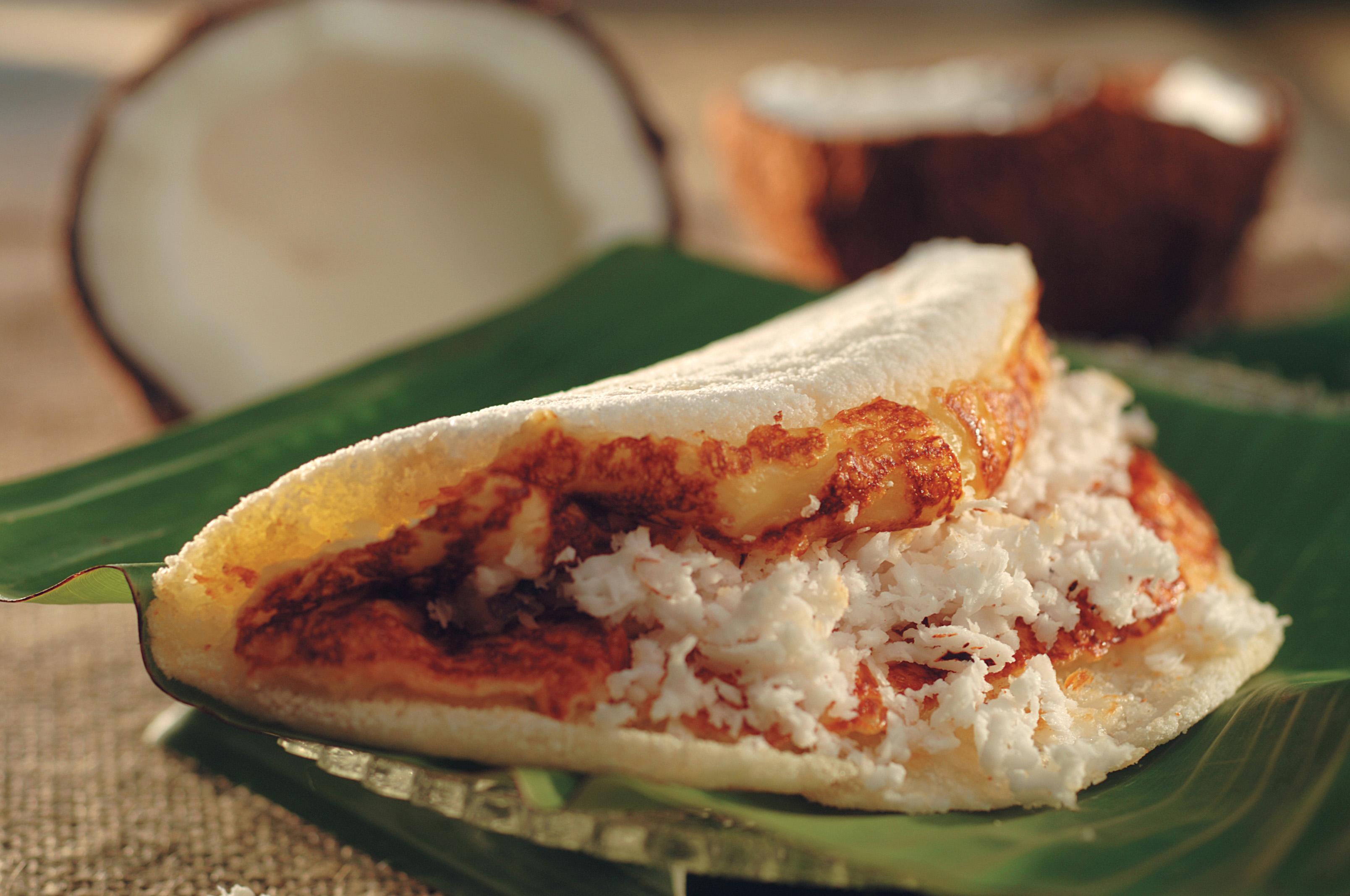 Tapioca de queijo com coco, da barraca de Lúcia Rosa do Nascimento, a tia Lu, tapioqueira do Alto da Sé.