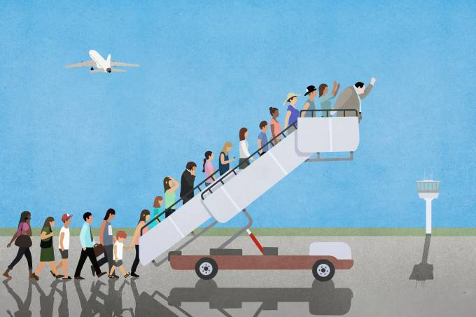 Passengers on mobile stairs on empty tarmac at airport